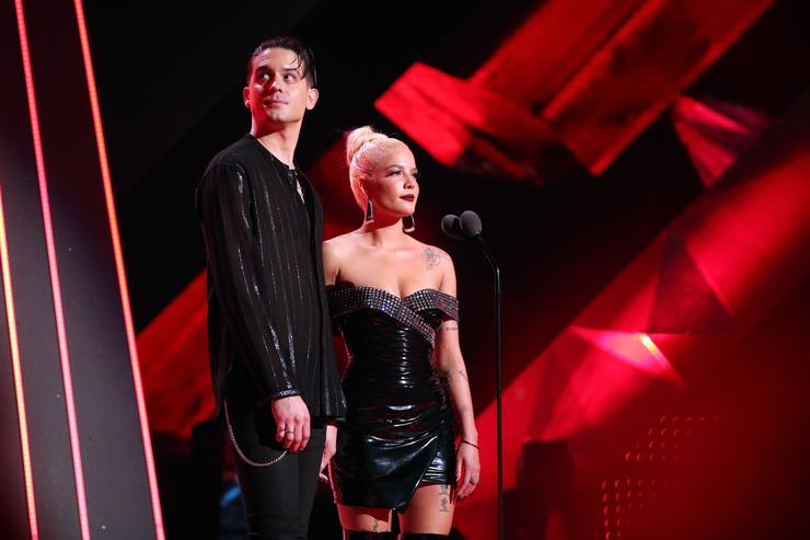 G-Eazy (L) and Halsey speak onstage during the 2018 iHeartRadio Music Awards which broadcasted live on TBS, TNT, and truTV at The Forum on March 11, 2018 in Inglewood, California
