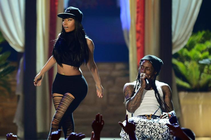 Nicki Minaj (L) and rapper Lil Wayne perform onstage during the 2013 Billboard Music Awards at the MGM Grand Garden Arena on May 19, 2013 in Las Vegas, Nevada
