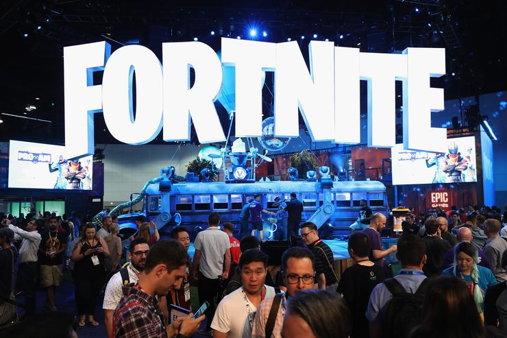 : Game enthusiasts and industry personnel visit the 'Fortnite' exhibit during the Electronic Entertainment Expo E3 at the Los Angeles Convention Center on June 12, 2018 in Los Angeles, California.