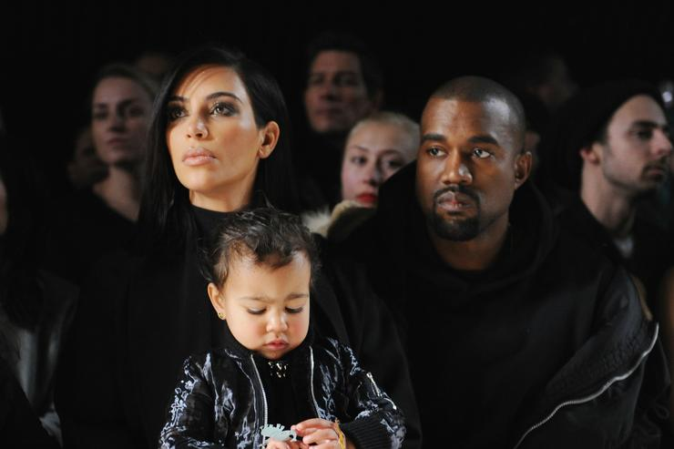 (L-R) Kim Kardashian, North West and Kanye West attend the Alexander Wang Fashion Show during Mercedes-Benz Fashion Week Fall 2015 at Pier 94 on February 14, 2015 in New York City.