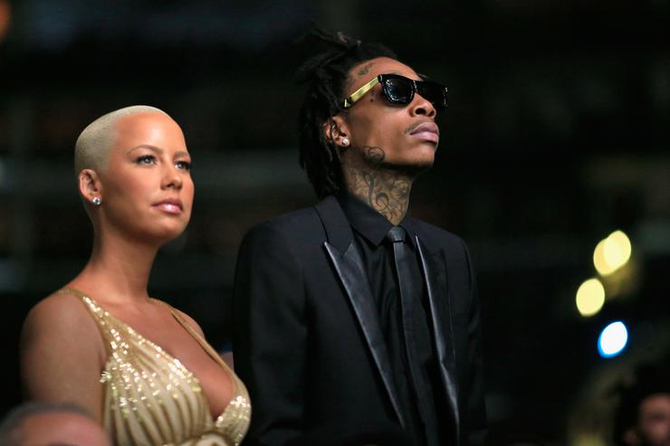 Wiz Khalifa featured wearing Converse in support of the GRAMMY Foundation's GRAMMY Camp and model Amber Rose attends the 56th GRAMMY Awards at Staples Center on January 26, 2014 in Los Angeles, California