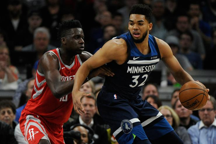 Clint Capela #15 of the Houston Rockets defends against Karl-Anthony Towns #32 of the Minnesota Timberwolves during the second quarter in Game Four of Round One of the 2018 NBA Playoffs on April 23, 2018 at the Target Center in Minneapolis, Minnesota.