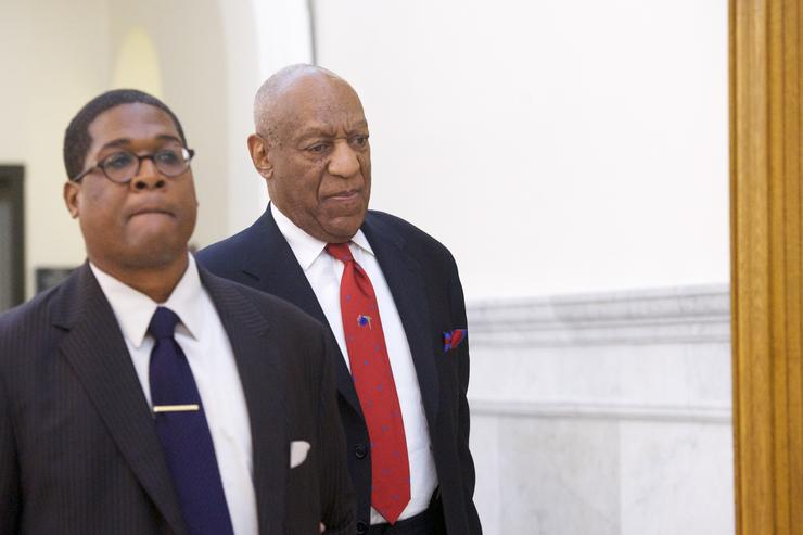 Bill Cosby (C) walks through the Montgomery County Courthouse with his publicist, Andrew Wyatt, after being found guilty on all counts in his sexual assault retrial on April 26, 2018 in Norristown, Pennsylvania.