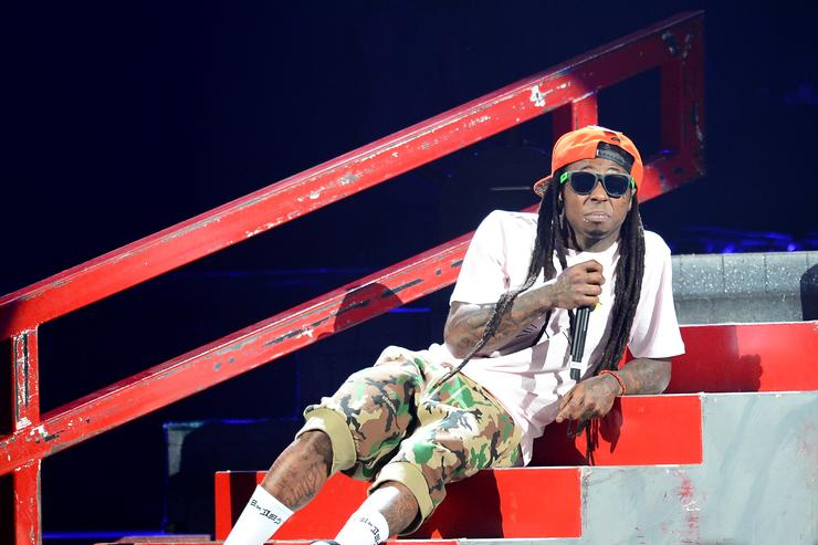 Lil Wayne performs during the America's Most Wanted Music Festival at the MGM Grand Garden Arena on August 31, 2013 in Las Vegas, Nevada
