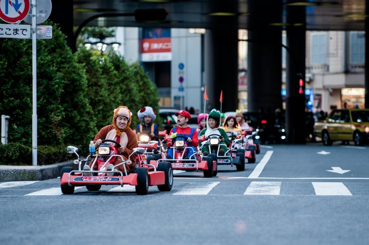 Participants drive around Tokyo in Mario Kart characters for the Real Mario Kart event in Tokyo on November 16, 2014 in Tokyo, Japan. The organizer calls for participants to this event held about once a month on Facebook, and Akiba Kart offers rental karts that can be driven on public streets.