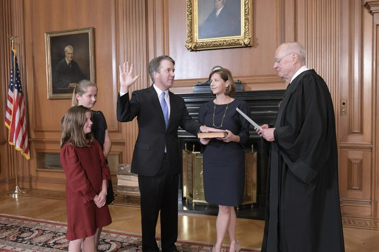 In this handout photo provided by the Supreme Court of the United States, Justice Anthony M. Kennedy, (Retired) administers the Judicial Oath to Judge Brett M. Kavanaugh as his wife Ashley Kavanaugh holds the Bible while joined by their daughters Margaret and Liza, in the Justices Conference Room at the Supreme Court Building on October 6, 2018 in Washington, DC.