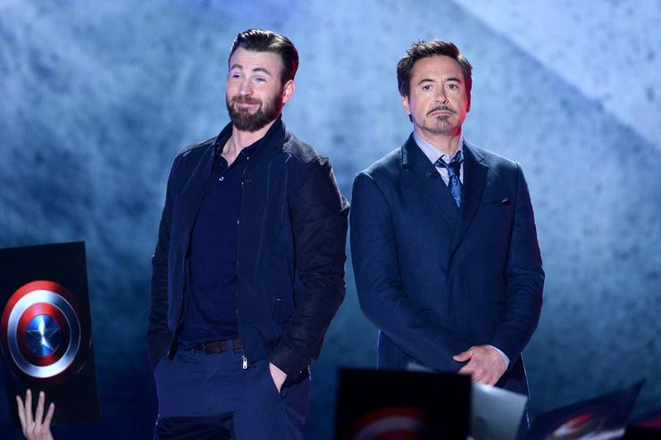 Actors Chris Evans (L) and Robert Downey Jr. speak onstage during Nickelodeon's 2016 Kids' Choice Awards at The Forum on March 12, 2016 in Inglewood, California.