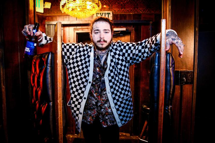 Post Malone behind the scenes before his Bud Light Dive Bar Tour show in Nashville at Footsies Dive Bar on March 20, 2018 in Los Angeles, California