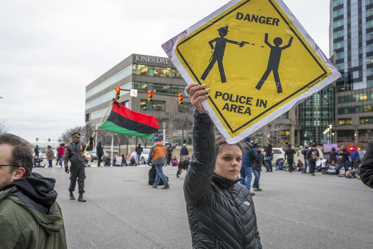 Katy Kostenko, a 19-year old resident of Cleveland, holds a sign in protest on December 29, 2015 in Cleveland, Ohio. Protestors took to the street the day after a grand jury declined to indict Cleveland Police officer Timothy Loehmann for the fatal shooting of Tamir Rice on November 22, 2014.