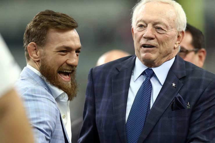 Conor McGregor visists with Dallas Cowboys owner Jerry Jones before the game against the Jacksonville Jaguars at AT&T Stadium on October 14, 2018 in Arlington, Texas.