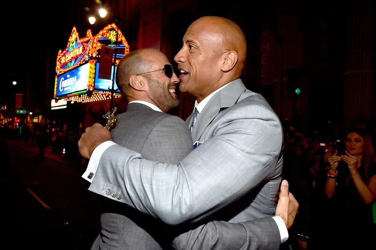 Actors Jason Statham (L) and Dwayne 'The Rock' Johnson attend Universal Pictures' 'Furious 7' premiere at TCL Chinese Theatre on April 1, 2015 in Hollywood, California.