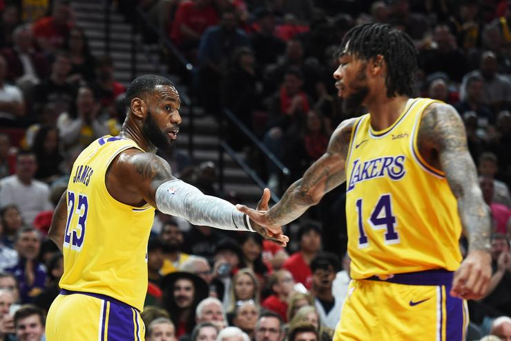 LeBron James #23 and Brandon Ingram #14 of the Los Angeles Lakers celebrate in the first quarter against the Portland Trail Blazers during their game at Moda Center