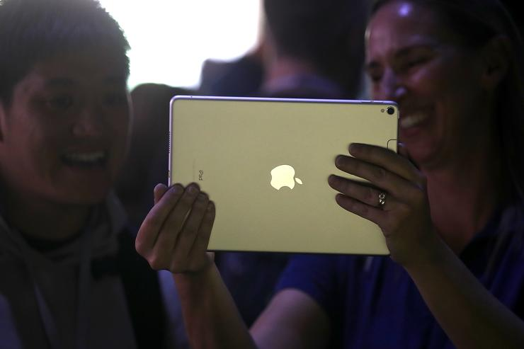 Attendees inspect the new iPad Pro during the 2017 Apple Worldwide Developer Conference (WWDC) at the San Jose Convention Center on June 5, 2017 in San Jose, California.