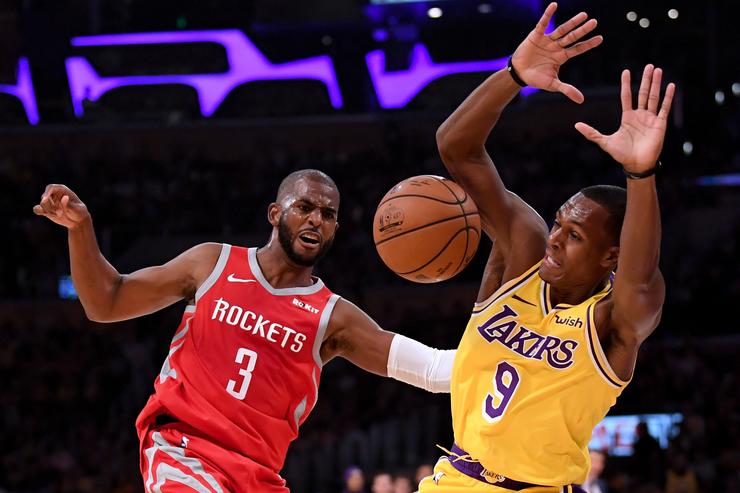 Chris Paul #3 of the Houston Rockets reacts to a foul from Rajon Rondo #9 of the Los Angeles Lakers during the second quarter at Staples Center on October 20, 2018 in Los Angeles, California.