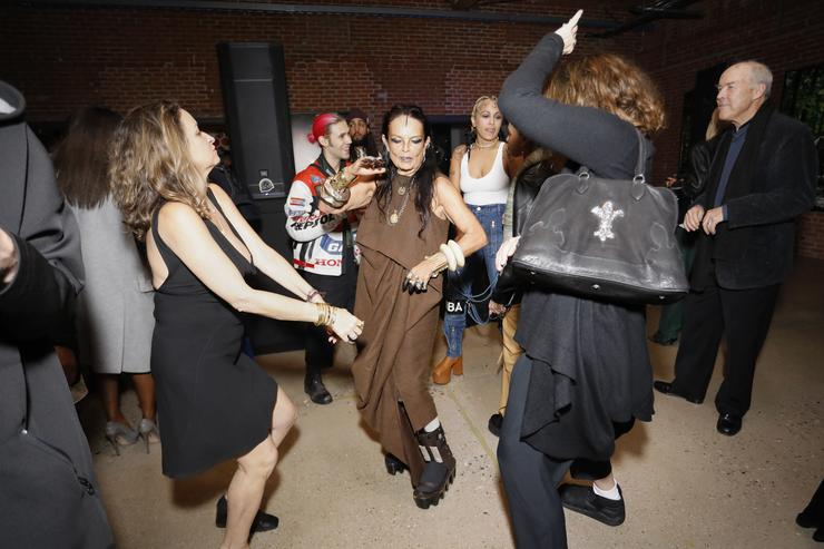 Michele Lamy, Organizer of 'Rick Owens: Furniture' (C) on the dance floor during MOCA's Leadership Circle and Members' Opening dinner party for 'Rick Owens: Furniture' on December 16, 2016 in Los Angeles, California.
