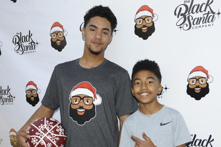 Kelvin Pena (L) and Miles Brown attend Baron Davis hosts Black Santa Celebrity Basketball Fundraiser on December 16, 2017 in Santa Monica, California.