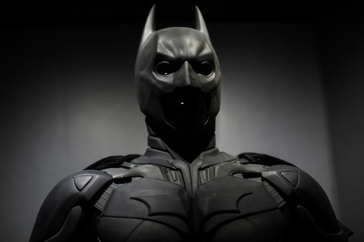 A Batman costume from the 2012 Dark Knight Rises film worn by Christian Bale and designed by Lindy Hemming is on display at the DC Comics Exhibition: Dawn Of Super Heroes at the O2 Arena on February 22, 2018 in London, England.