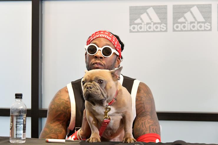 2 Chainz and his dog Trappy speak during a press conference at adidas Creates 747 Warehouse St., an event in basketball culture, on February 16, 2018 in Los Angeles, California