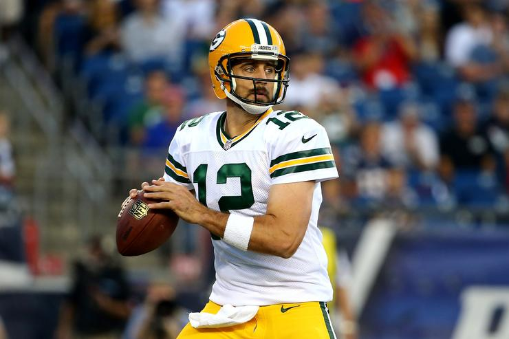 Quarterback Aaron Rodgers #12 of the Green Bay Packers looks to make a pass in the first quarter against the Los Angeles Rams at Los Angeles Memorial Coliseum on October 28, 2018 in Los Angeles, California.