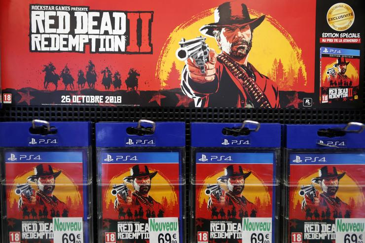 Red Dead Redemption 2 (RD 2) video games for Sony PlayStation PS4 developed by Rockstar Studios and published by Rockstar Games are displayed inside a shop during the 'Paris Games Week' on October 27, 2018 in Paris, France