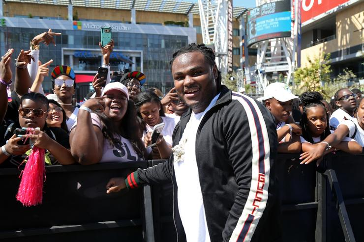 Recording artist Tee Grizzley poses with fans during day one of BETX Live!, presented by Denny's, during the 2017 BET Experience on June 22, 2017 in Los Angeles, California.