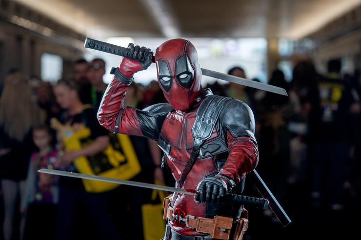 A fan cosplays as Deadpool from the Marvel Universe during the 2018 New York Comic-Con at Javits Center on October 7, 2018 in New York City.