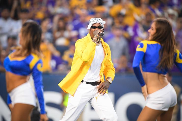 YG performs at the Los Angeles Rams game against the Minnesota Vikings at Los Angeles Memorial Coliseum on September 27, 2018 in Los Angeles, California