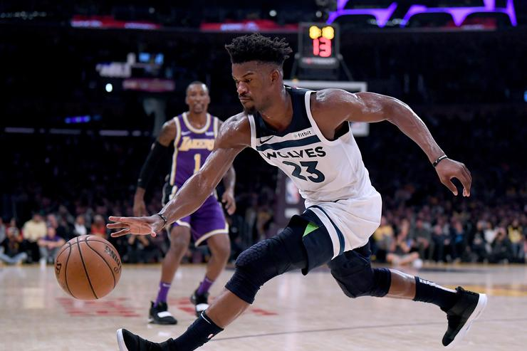 Jimmy Butler #23 of the Minnesota Timberwolves reaches for a loose ball during a 114-110 loss to the Los Angeles Lakers at Staples Center on November 7, 2018 in Los Angeles, California.