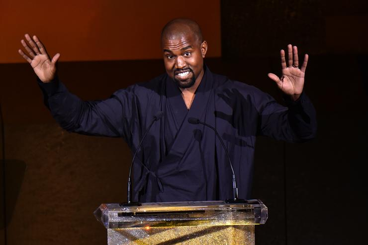 Kanye West presents the Fashion Icon Award to Pharrell Williams onstage at the 2015 CFDA Fashion Awards at Alice Tully Hall at Lincoln Center on June 1, 2015 in New York City.
