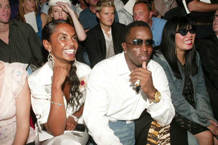 Sean 'P. Diddy' Combs and girlfriend Kim Porter attend the Marc Jacobs Spring/Summer 2004 Collection at the Manhattan Armory during the 7th on Sixth Mercedes-Benz Fashion Week on September 15, 2003 in New York City.