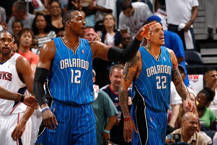 Dwight Howard #12 and Matt Barnes #22 of the Orlando Magic against the Atlanta Hawks during Game Three of the Eastern Conference Semifinals during the 2010 NBA Playoffs at Philips Arena on May 8, 2010 in Atlanta, Georgia