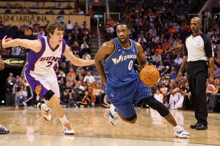 : Gilbert Arenas #0 of the Washington Wizards drives the ball past Goran Dragic #2 of the Phoenix Suns during the NBA game at US Airways Center on December 19, 2009 in Phoenix, Arizona.