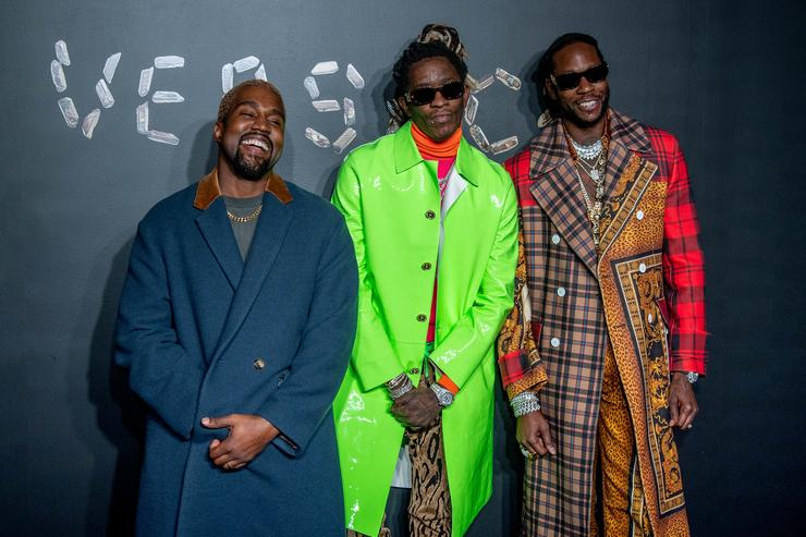 Kanye West, Young Thug and 2 Chainz attend the the Versace fall 2019 fashion show at the American Stock Exchange Building in lower Manhattan on December 02, 2018 in New York City