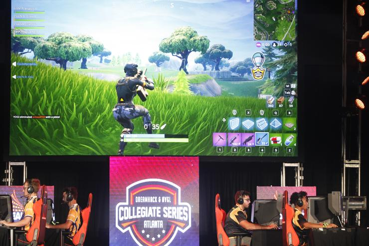 Students from Louisiana State University and The University of Washington compete in the online game Fortnite during DreamHack Atlanta 2018 at the Georgia World Congress Center on November 16, 2018 in Atlanta, Georgia.