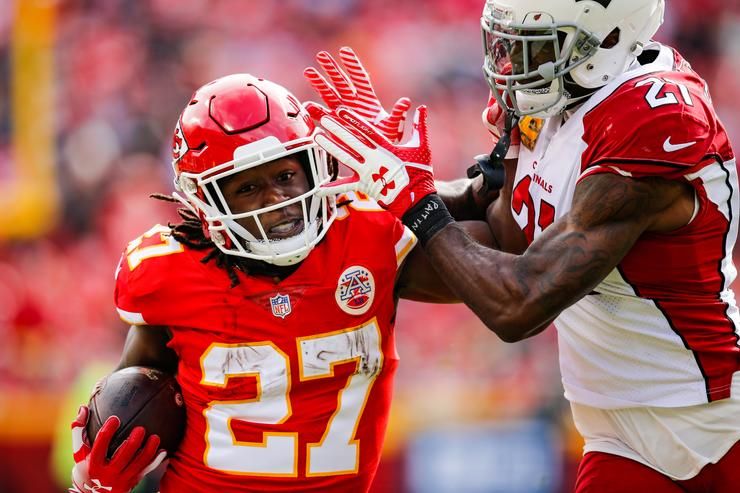 Kareem Hunt #27 of the Kansas City Chiefs tries to fight off a tackle from Patrick Peterson #21 of the Arizona Cardinals during the first half of the game at Arrowhead Stadium on November 11, 2018 in Kansas City, Missouri.