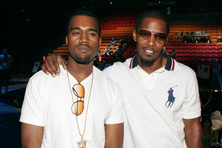 Kanye West (L) and singer/actor Jamie Foxx pose on stage during rehearsals for the 2005 MTV Video Music Awards at the American Airlines Arena August 27, 2005 in Miami, Florida
