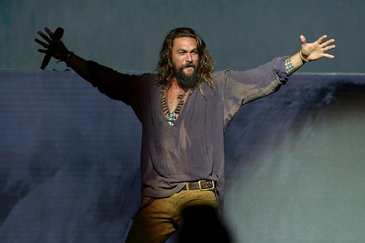 Jason Momoa walks onstage at the Warner Bros. 'Aquaman' theatrical panel during Comic-Con International 2018 at San Diego Convention Center on July 21, 2018 in San Diego, California.