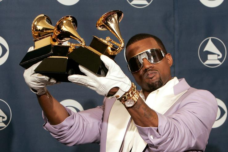 Singer Kanye West poses with his Best Rap Song, Best Rap Solo Performance and Best Rap Album awards in the press room at the 48th Annual Grammy Awards at the Staples Center on February 8, 2006 in Los Angeles, California.