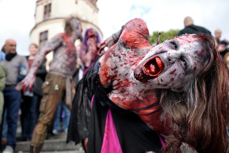 Participants take part at the Zombie Walk Duesseldorf along the Rheinuferpromenade on September 6, 2015 in Duesseldorf, Germany. A zombie walk is an organized public gathering of people who dress up in zombie costumes.