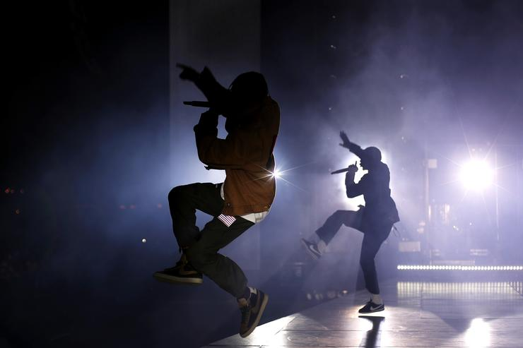Rappers Travis Scott (L) and Kendrick Lamar perform on the Coachella Stage during day 3 of the Coachella Valley Music And Arts Festival (Weekend 1) at the Empire Polo Club on April 16, 2017 in Indio, California.