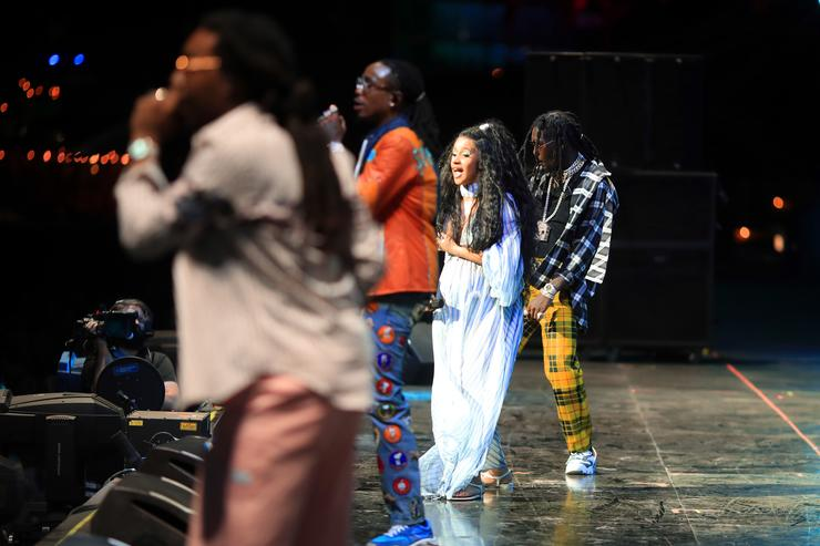 Cardi B (2nd R) performs with (L-R) Takeoff, Quavo, and Offset of Migos onstage during the 2018 Coachella Valley Music And Arts Festival at the Empire Polo Field on April 22, 2018 in Indio, California