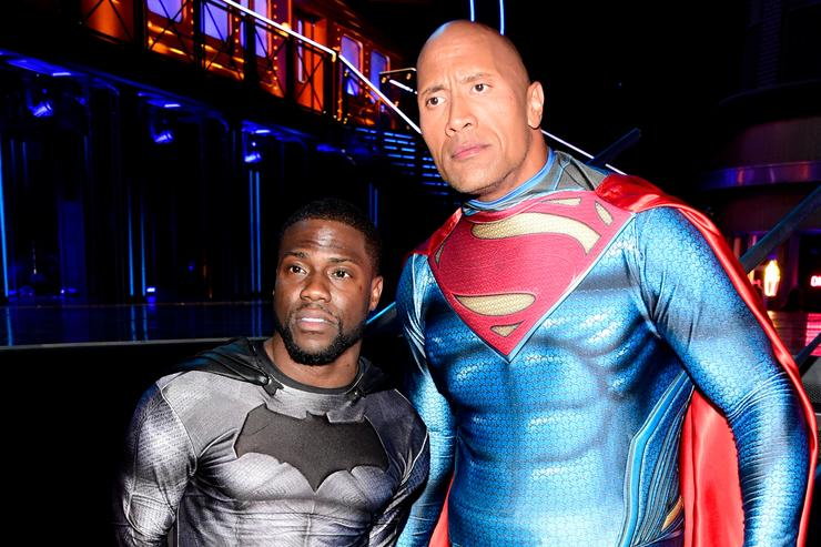 Kevin Hart (L) and Dwayne Johnson pose backstage during the 2016 MTV Movie Awards at Warner Bros. Studios on April 9, 2016 in Burbank, California