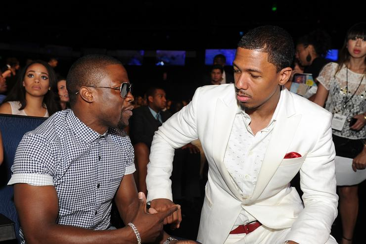 : Comedian Kevin Hart (L) and TV personality Nick Cannon in the audience during the 2013 BET Awards at Nokia Theatre L.A. Live on June 30, 2013 in Los Angeles, California.