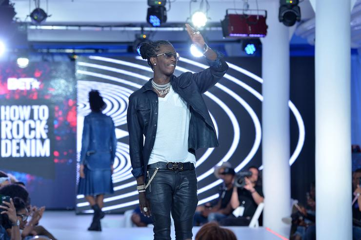 Young Thug greets the audience from the runway during the BET How To Rock: Denim show at Milk Studios on August 10, 2016 in New York City.