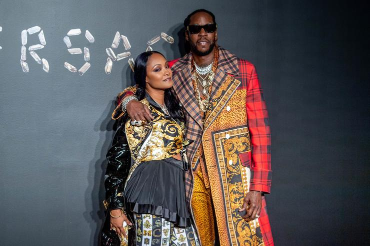 Kesha Ward and 2 Chainz attend the the Versace fall 2019 fashion show at the American Stock Exchange Building in lower Manhattan on December 02, 2018 in New York City