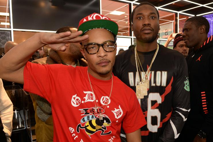 T.I. and Meek Mill make a special appearance at The PUMA Lab Powered by Foot Locker at Foot Locker at the Gallery at South Dekalb Mall on February 6, 2014 in Atlanta, Georgia