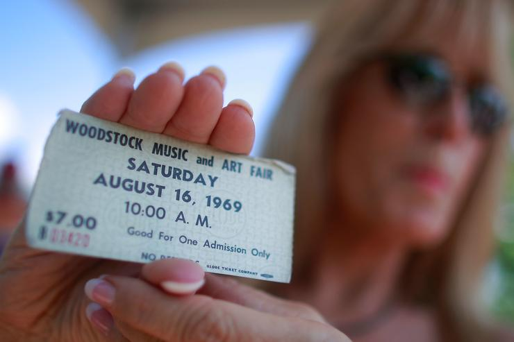 Janet Huey holds her original concert ticket as the 40th anniversary of the Woodstock music festival approaches August 14, 2009 in Bethel, New York. On August 15-17 in 1969 an estimated 400,000 music fans gathered on Max Yasgur's farm in Bethel, N.Y. for the most celebrated music festival ever. The 40th anniversary concert will take place tomorrow.