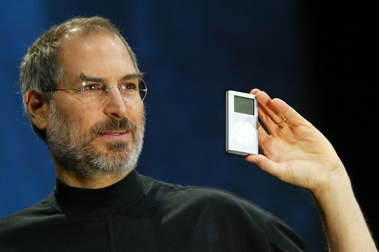 Apple CEO Steve Jobs holds a new mini iPod at Macworld January 6, 2004 in San Francisco. Jobs announced several new products including the new iLife 4 software and the Mini iPod.