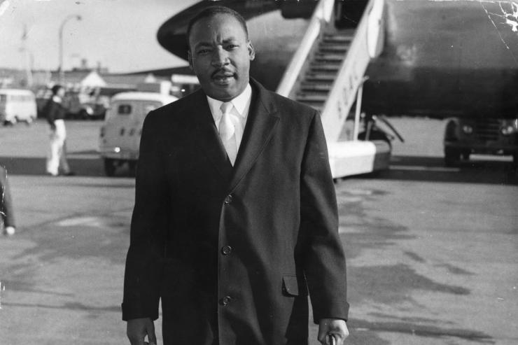 American civil rights campaigner Martin Luther King (1929 - 1968) arriving at London Airport. He is in England to be the chief speaker at a public meeting about colour prejudice and to appear on the BBC television programme 'Face To Face'.