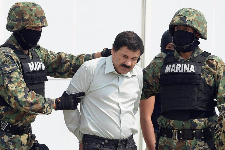 Mexican drug trafficker Joaquin Guzman Loera aka 'el Chapo Guzman' (C), is escorted by marines as he is presented to the press on February 22, 2014 in Mexico City. Mexican drug lord Joaquin 'El Chapo' Guzman has escaped from a maximum-security prison for the second time in 14 years, sparking a massive manhunt Sunday and dealing an embarrassing blow to the government.
